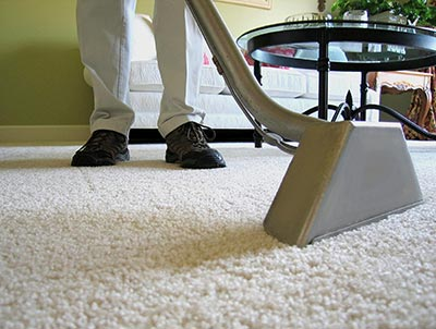 A man while giving carpet cleaning service in an office